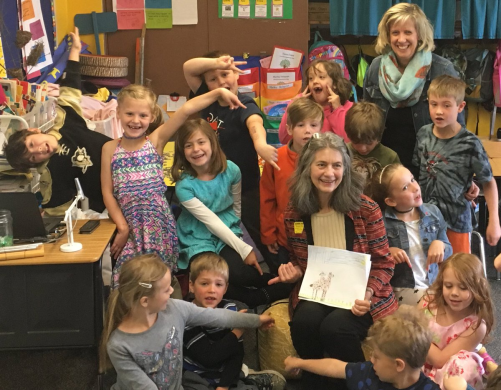 Susan Koch's first grade class shares reactions to a reading by guest author Christy Mihaly